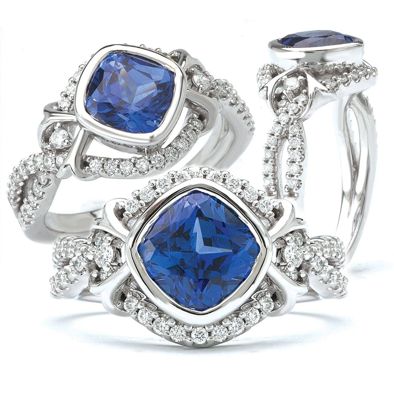 Finished blue sapphire and diamond infinity style engagement ring